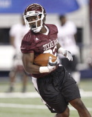 Cyrus Gray carries the ball during Texas AM's practice for the ATT Cotton Bowl at Cowboys Stadium in Arlington Texas on Tuesday January 4 2011 The...