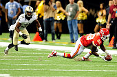 Cyrus Gray of the Kansas City Chiefs catches a pass in front of Dion Turner of the New Orleans Saints during a game at the MercedesBenz Superdome on...