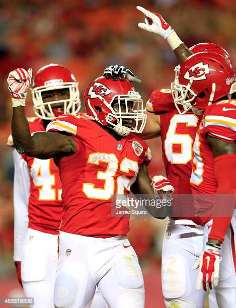 Cyrus Gray of the Kansas City Chiefs celebrates scoring a touchdown with his teammates against the Cincinnati Bengals at Arrowhead Stadium on August...