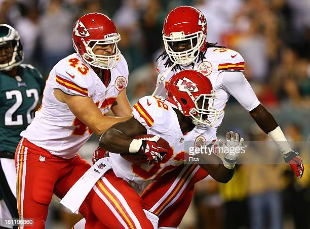 Cyrus Gray of the Kansas City Chiefs celebrates with teammates after recovering a fumble against the Philadelphia Eagles in the first quarter at...