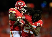 Cyrus Gray of the Kansas City Chiefs is congratulated bu Jamaal Charles after scoring a touchdown during the preseason game against the Cincinnati...