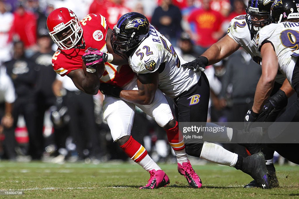 Cyrus Gray #32 of the Kansas City Chiefs is knocked backwards by Ray Lewis #52 of the Baltimore Ravens midway in the fourth quarter on October 07, 2012 at Arrowhead Stadium in Kansas City, Missouri.