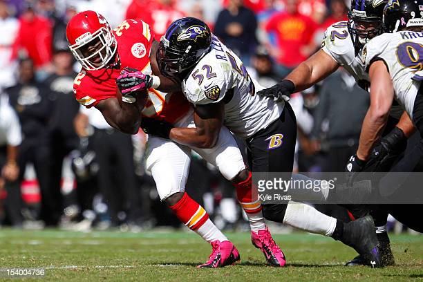 Cyrus Gray of the Kansas City Chiefs is knocked backwards by Ray Lewis of the Baltimore Ravens midway in the fourth quarter on October 07 2012 at...