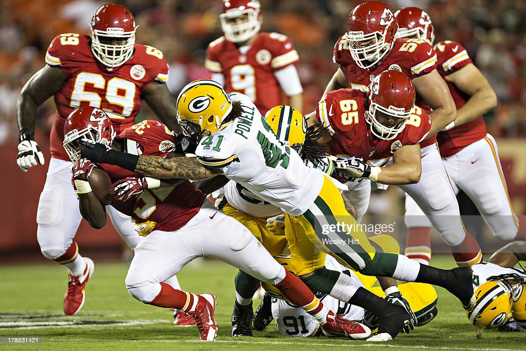 <a gi-track='captionPersonalityLinkClicked' href=/galleries/search?phrase=Cyrus+Gray&family=editorial&specificpeople=5573455 ng-click='$event.stopPropagation()'>Cyrus Gray</a> #32 of the Kansas City Chiefs is tackled by Chaz Powell #41 of the Green Bay Packers during the last preseason game at Arrowhead Stadium on August 29, 2013 in Kansas CIty, Missouri.