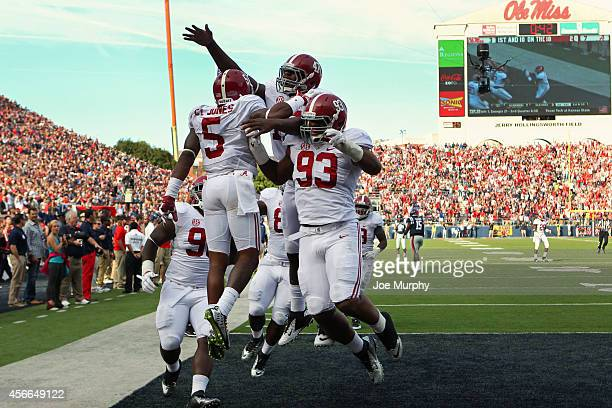 Cyrus Jones of the Alabama Crimson Tide celebrates his touchdown with Xzavier Dickson and Jonathan Allen against the Ole Miss Rebels on October 4...