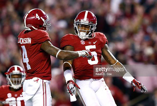 Cyrus Jones of the Alabama Crimson Tide reacts after intercepting a touchdown reception intended for De'Runnya Wilson of the Mississippi State...
