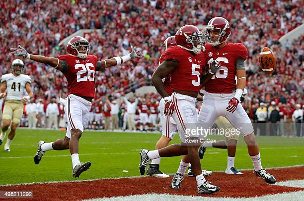 Cyrus Jones of the Alabama Crimson Tide reacts after returning a punt for a touchdown against the Charleston Southern Buccaneers with Richard...
