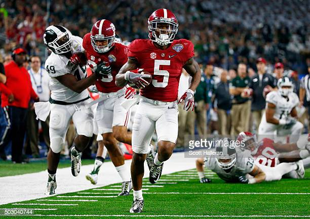 Cyrus Jones of the Alabama Crimson Tide returns a punt for a 55 yard touchdown in the third quarter against the Michigan State Spartans during the...