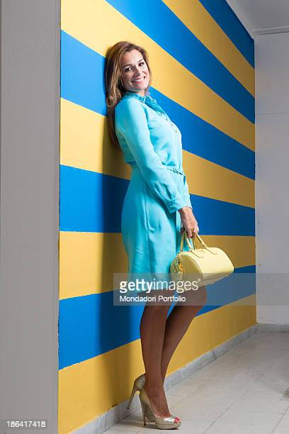 Czech actress Alena Seredova honorary president of the Carrarese football club posing smiling leaning against a wall painted with the colours of her...