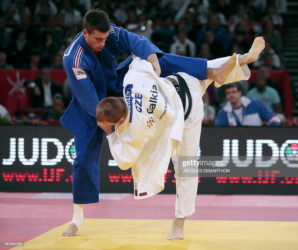 Czech Alexandr Jurecka (white) fights against France's Alexandre Iddir (blue) on February 10, 2013 in Paris, during the eliminatories of the Men -90kg of the Paris Judo Grand Slam tournament. AFP PHOTO