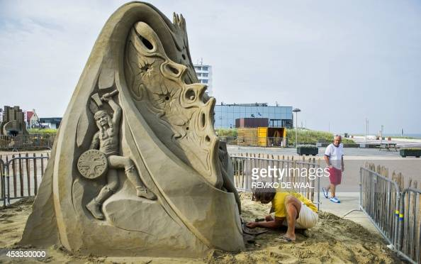 Czech artist Jan Zelinka works on his sand sculpture during the third European Championship Sand Sculpting in Zandvoort aan Zee The Netherlands on...