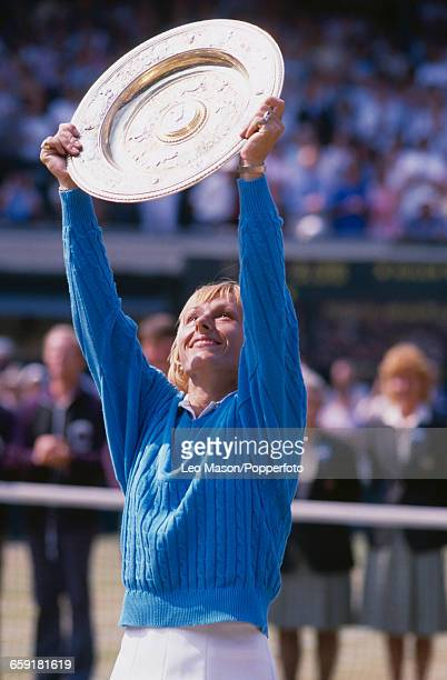 Czech born American tennis player Martina Navratilova holds the Venus Rosewater Dish trophy up in the air after winning the final of the Ladies'...