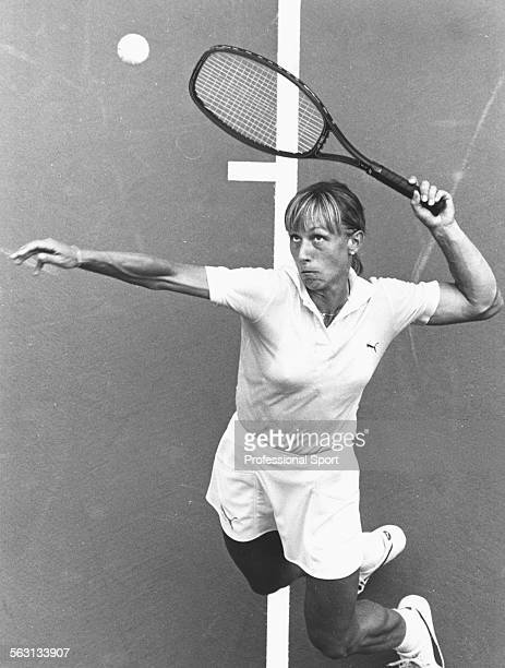 Czech born American tennis player Martina Navratilova reaches up to serve during a match at the US Open Tennis Championships at Flushing Meadow New...
