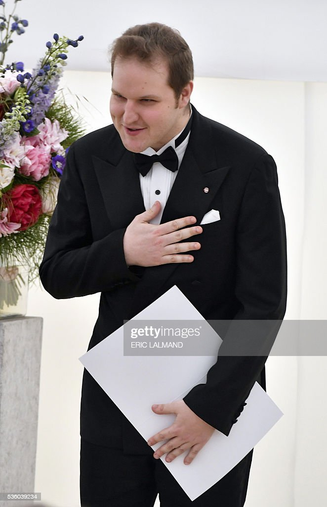 Czech contestant Lukas Vondracek gestures during the award ceremony after winning the Queen Elisabeth Piano Competition 2016 at the Queen Elisabeth Music Chapel in Waterloo, on May 31, 2016. / AFP / BELGA / ERIC LALMAND / Belgium OUT