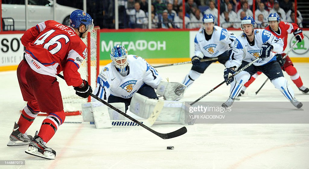 Czech David Krejci (L) attakcs Finnish goalie Petri Vehanen (C) during their game for the third place on May 20, 2012 at the International Ice Hockey World Championship in Helsinki.