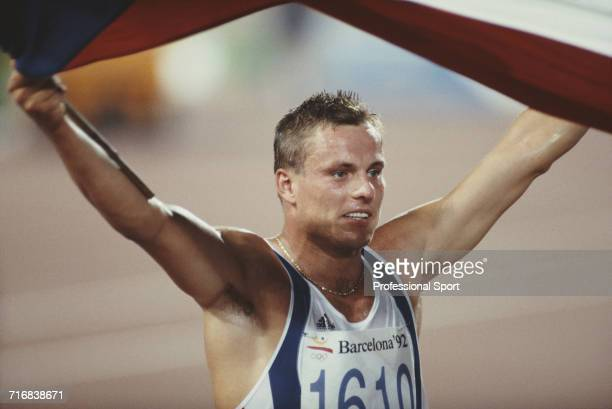Czech decathlete Robert Zmelik celebrates with the Czech national flag after running the 1500 metres final discipline on the 2nd day of competition...