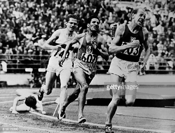 Czech Emil Zatopek leads on July 261952 in front of French Alain Mimoun and German Herbert Schade during the Olympic 5000m in Helsinki During his...