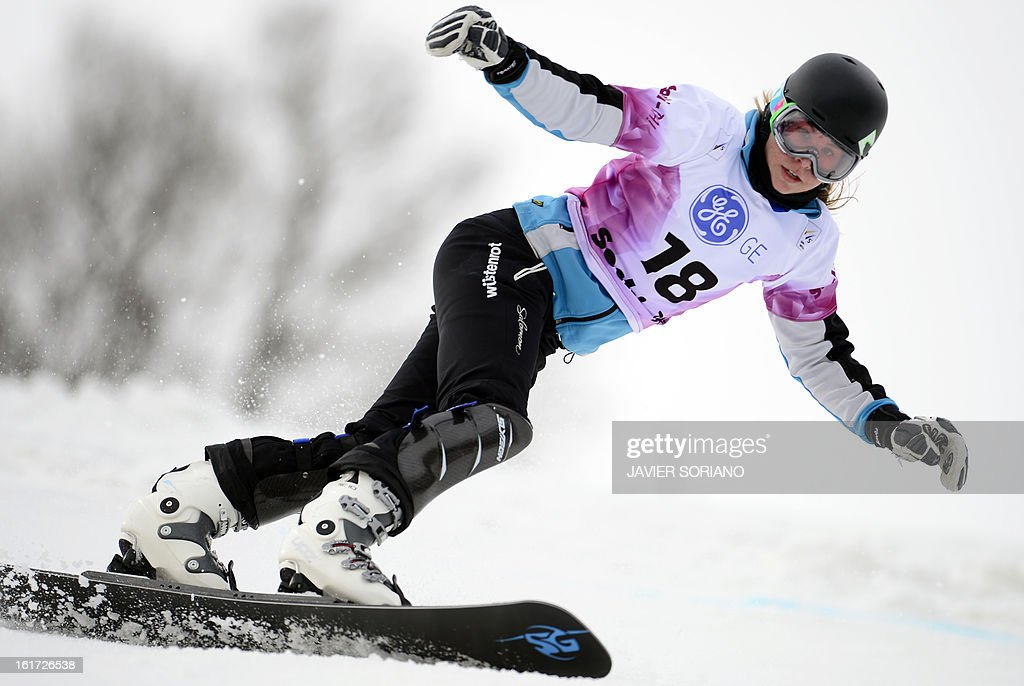 Czech Ester Ledecka competes in a Snowboard Ladies' Parallel Giant Slalom final race during the Snowboarding and Free Style World Cup Test Event at the Snowboard and Free Style Centre in Rosa Khutor near the Russian Black Sea resort of Sochi on February 14, 2013. Austrian Marion Kreinerwon the race ahead of German Ameli Kober and Canadian Ariane Lavigne.