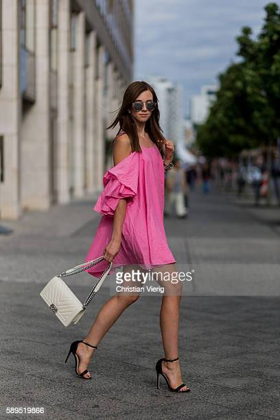 Czech fashion blogger Barbora Ondrackova wearing a pink off shoulder dress from Storets a white Chanel bag Dior sunglasses and Asos heels on August...