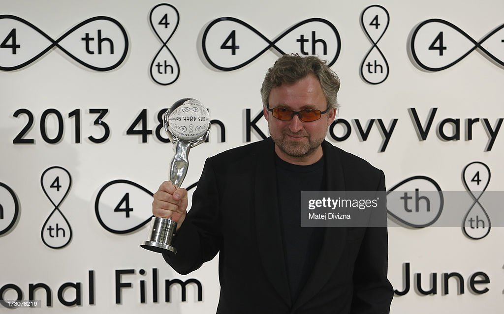 Czech film director Jan Hrebejk poses with the Crystal Globe, Best director award at the closing ceremony of the 48th Karlovy Vary International Film Festival (KVIFF) on July 06, 2013 in Karlovy Vary, Czech Republic.