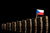 Czech flag with lot of coins isolated on black background