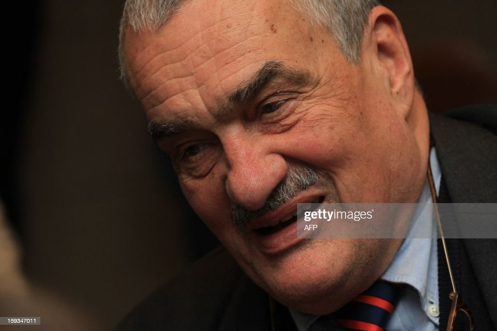 Czech Foreign Minister Karel Schwarzenberg waits for the results of the presidential elections in Prague, on January 12, 2013.The pipe-smoking Schwarzenberg, chairman of the right-wing governing coalition TOP 09 party, has promised to quit his party if elected president.AFP PHOTO / RADEK MICA