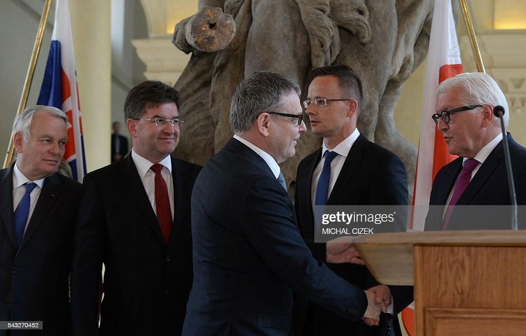 Czech Foreign Minister Lubomír Zaoralek (3R) shakes hands with Germany Foreign Minister Frank-Walter Steinmeier (R) next to (LtoR) French Foreign Minister Jean-Marc Ayrault, Slovakian Foreign Minister Miroslav Lajcak and Hungarian Foreign Minister Peter Szijjarto after a joint press conference of V4 Visegrad Group Foreign Ministers plus German and French Foreign Ministers meeting after the Brexit referendum on June 27, 2016, in Prague. / AFP / Michal Cizek