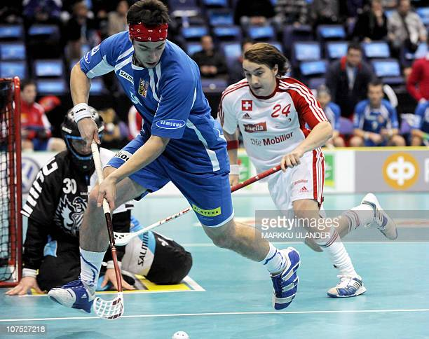 Czech goalie David Rytych looks at Czech Stepan Slany and Swiss Jan Binggeli fighting for the ball during the World Floorball Championship 2010...