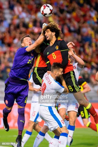 Czech goalkeeper Jiri Pavlenka and Belgium's Marouane Fellaini fight for the ball during the friendly football match between Belgium and Czech...