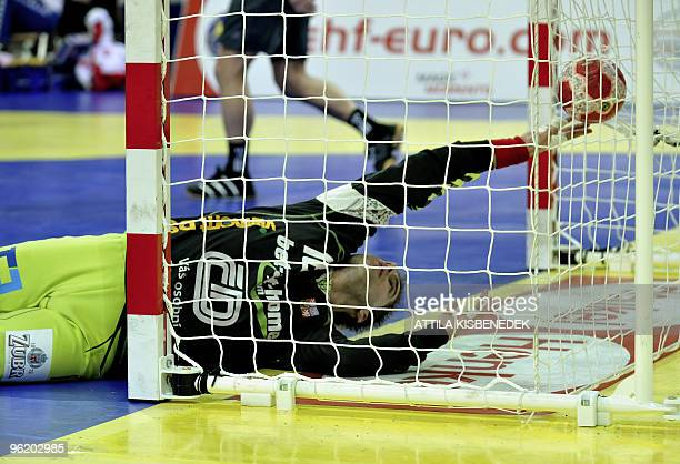 Czech goalkeeper Martin Galia grads a ball against Poland in the Olympic Hall of Innsbruck on January 26 2010 during the Euro 2010 Handball Main...
