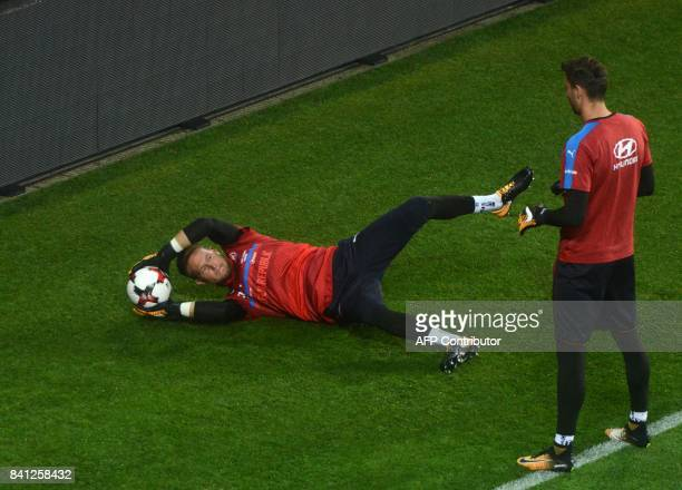 Czech goalkeepers Jiri Pavlenka and Tomas Vaclik take part in a training session on August 31 2017 at the Eden Arena in Prague on the eve of their...