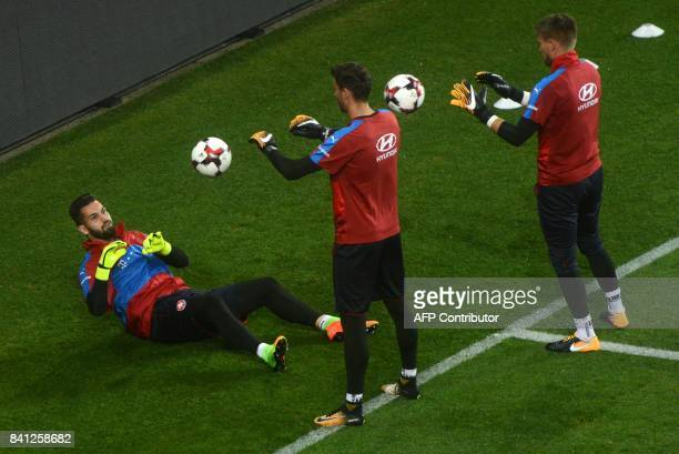 Czech goalkeepers Jiri Pavlenka Tomas Vaclik and Tomas Koubek take part in a training session on August 31 2017 at the Eden Arena in Prague on the...