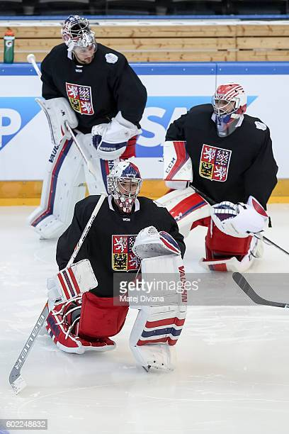 Czech goalkeepers Petr Mrazek Michal Neuvirth and Ondrej Pavelec warm up before a practice for the 2016 World Cup Of Hockey preparation match between...