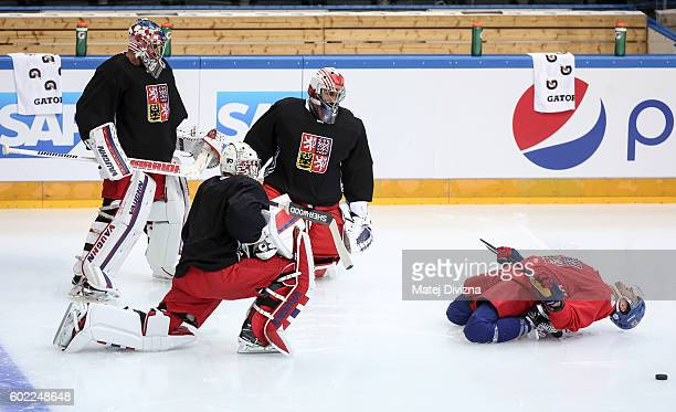 Czech goalkeepers Petr Mrazek Michal Neuvirth Ondrej Pavelec and their team mate David Pastrnak warm up before a practice for the 2016 World Cup Of...