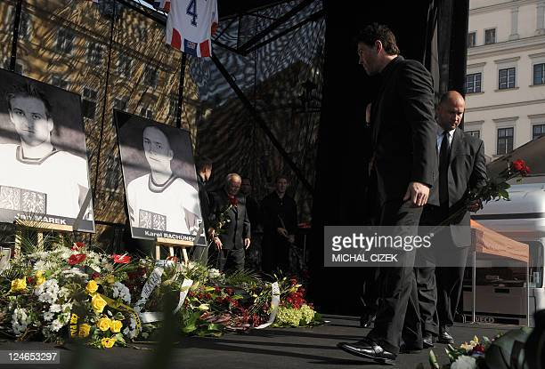 Czech Ice hockey players Jaromir Jagr and Jiri Slegr pay tributetor their teammates Josef Vasicek Jan Marek and Karel Rachunek who died during the...