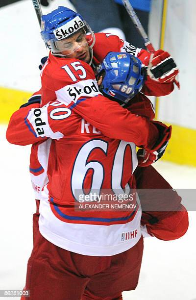 Czech Jan Marek congratulates Tomas Rolinek's with scoring during their preliminary round group D game of the IIHF International Ice Hockey World...