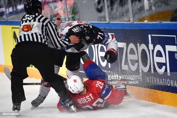 Czech linesman Libor Suchanek tries to separate Canada's forward Alex Killorn fighting with Norway's forward Niklas Roest during the IIHF Men's World...