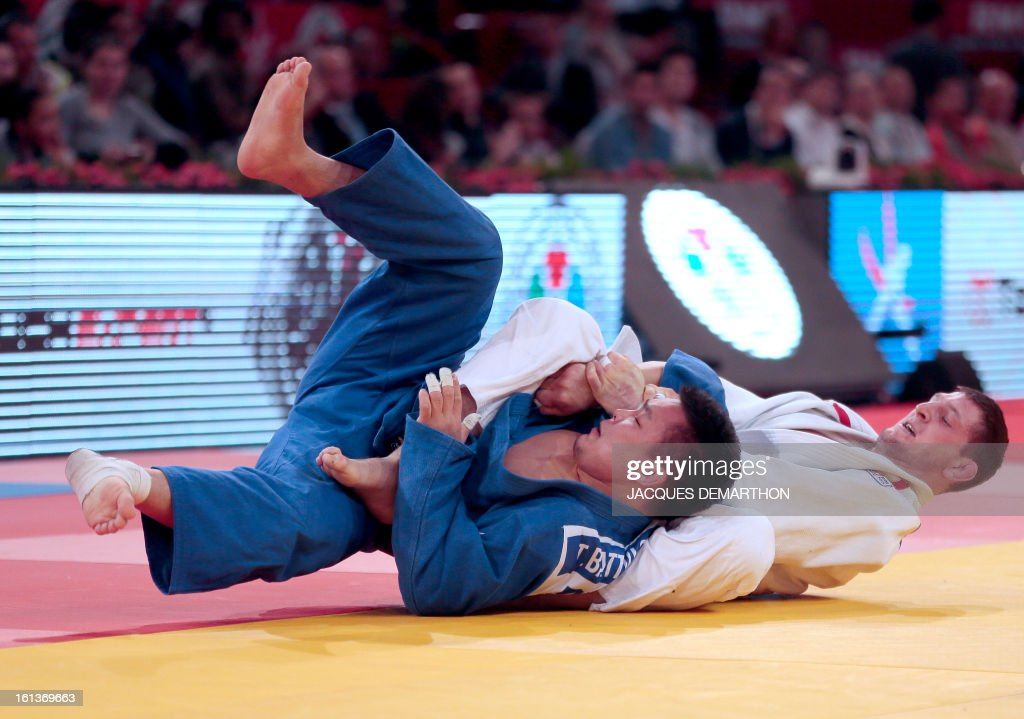 Czech Lukas Krpalek (white) competes with Mongolia's Temuulen Battulga during the Men -100kg contest final match of the Paris' Judo Grand Slam tournament on february 10, 2013 in Paris. AFP PHOTO / JACQUES DEMARTHON