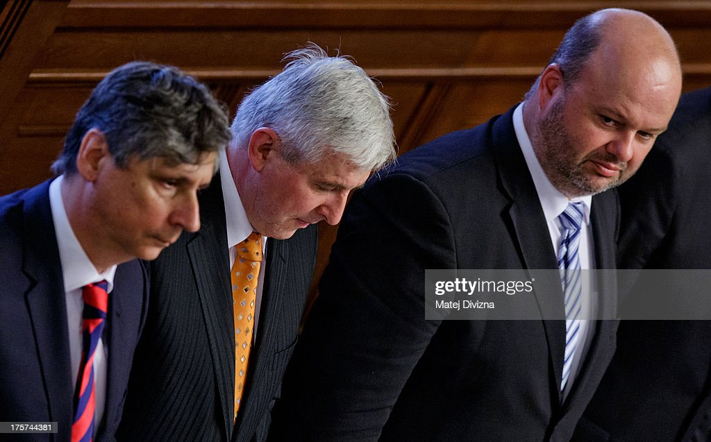 Czech Minister of Finance <a gi-track='captionPersonalityLinkClicked' href=/galleries/search?phrase=Jan+Fischer&family=editorial&specificpeople=4250425 ng-click='$event.stopPropagation()'>Jan Fischer</a> (L-R), Czech Prime Minister Jiri Rusnok and Czech Minister of Interior Martin Pecina attend a confidence vote at the Czech Chamber of Deputies on August 7, 2013 in Prague, Czech Republic. Rusnok's caretaker cabinet was appointed in July by Czech President Milos Zeman and lost a vote of confidence today.