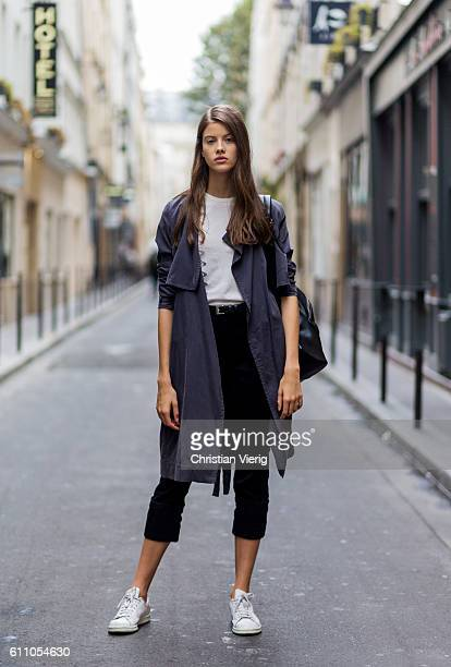 Czech model Babora Podzimkova wearing a trench coat and cropped pants and backpack on September 28 2016 in Paris France