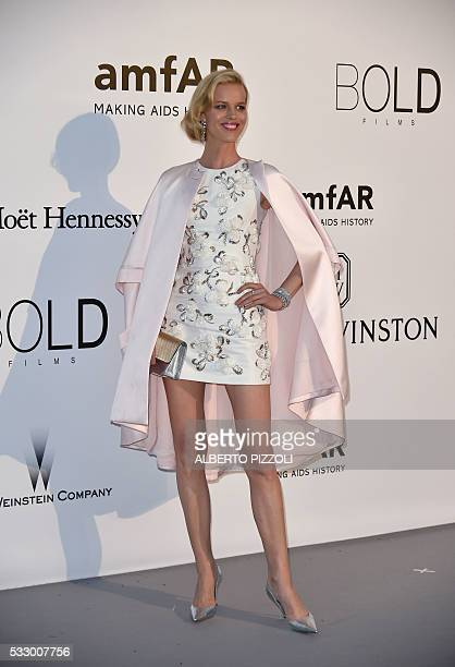 Czech model Eva Herzigova poses as she arrives for the amfAR's 23rd Cinema Against AIDS Gala on May 19 2016 at the Hotel du CapEdenRoc in Cap...