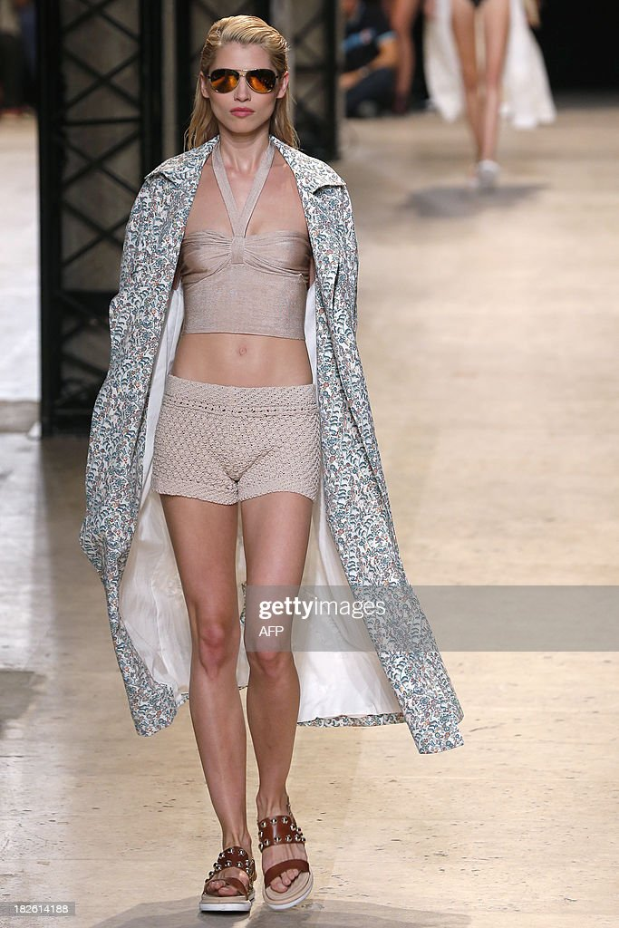 Czech model Hana Jirickova presents a creation for Paul & Joe during the 2014 Spring/Summer ready-to-wear collection fashion show, on October 1, 2013 in Paris.