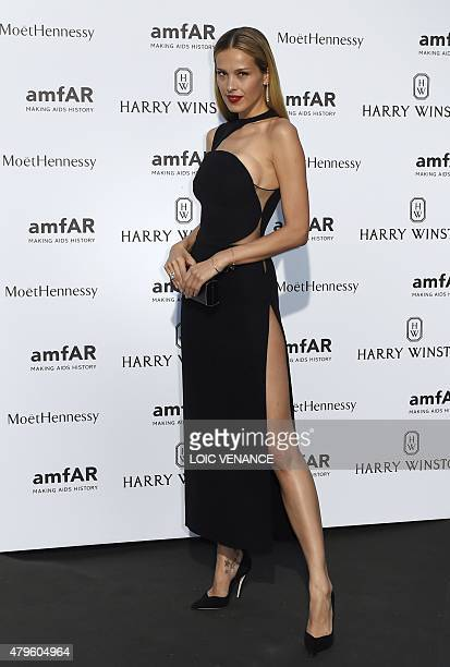 Czech model Petra Nemcova poses prior to the Amfar dinner on the sidelines of the Paris fashion week on July 5 2015 in Paris AFP PHOTO / LOIC VENANCE