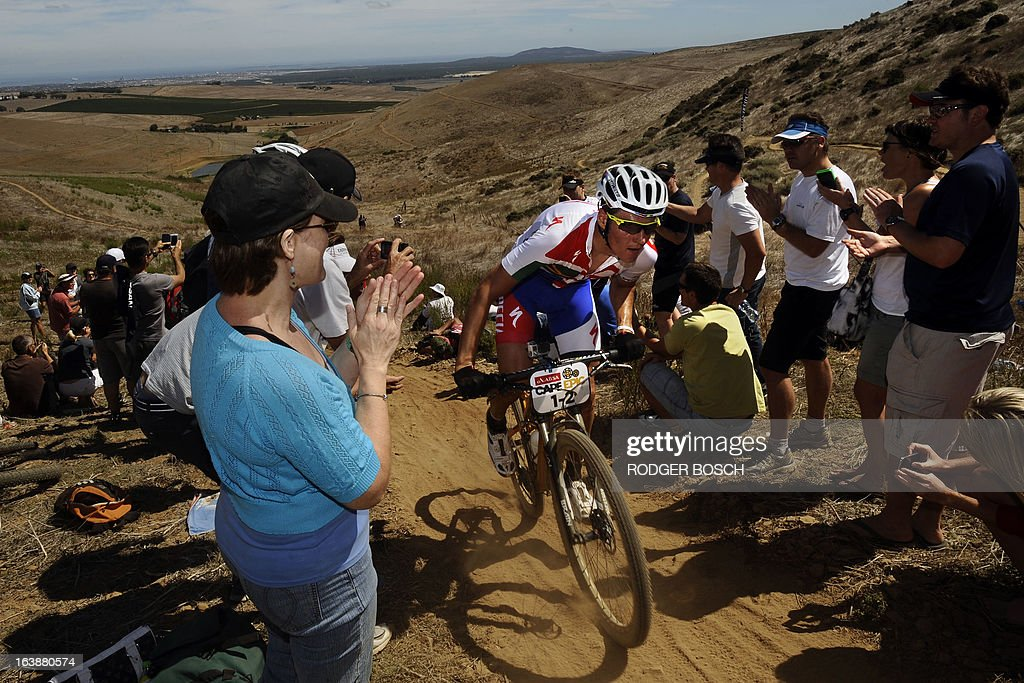 Czech Olympic gold medalist Jaroslav Kulhavy riding for the Burry Stander Songo Team pedals up a hill on March 17, 2013 during the prolog stage of the 2013 Cape Epic Mountain Bike Race at the Meerendal Wine estate, about 30 kms from Cape Town. The eight-day race covers a distance of more than 800 kms, climbing more than 15,000 meters. AFP PHOTO / RODGER BOSCH