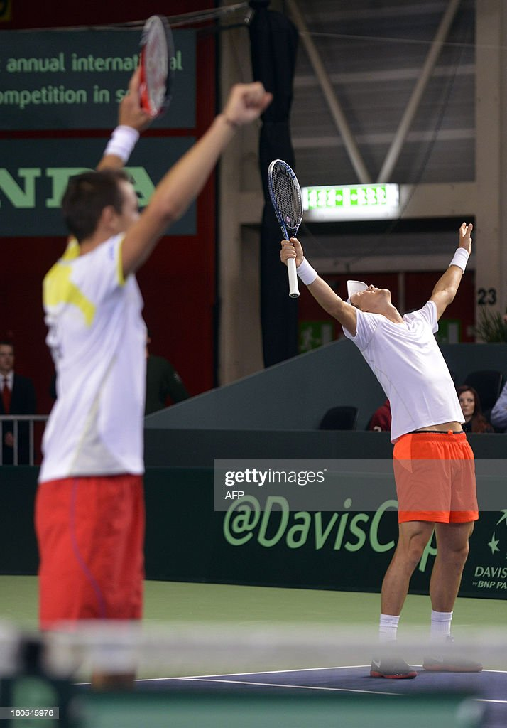 Czech pair Tomas Berdych (R) and Lukas Rosol celebrate their victory against Swiss player Stanislas Wawrinka and Marco Chiudinelli in the Davis Cup first round match, on February 2, 2013 in Geneva. The Czech Republic's Tomas Berdych and Lukas Rosol defeated Stanislas Wawrinka and Marco Chiudinelli of Switzerland 6-4, 5-7, 6-4, 6-7 (3/7), 24-22 in the longest Davis Cup rubber of all time.