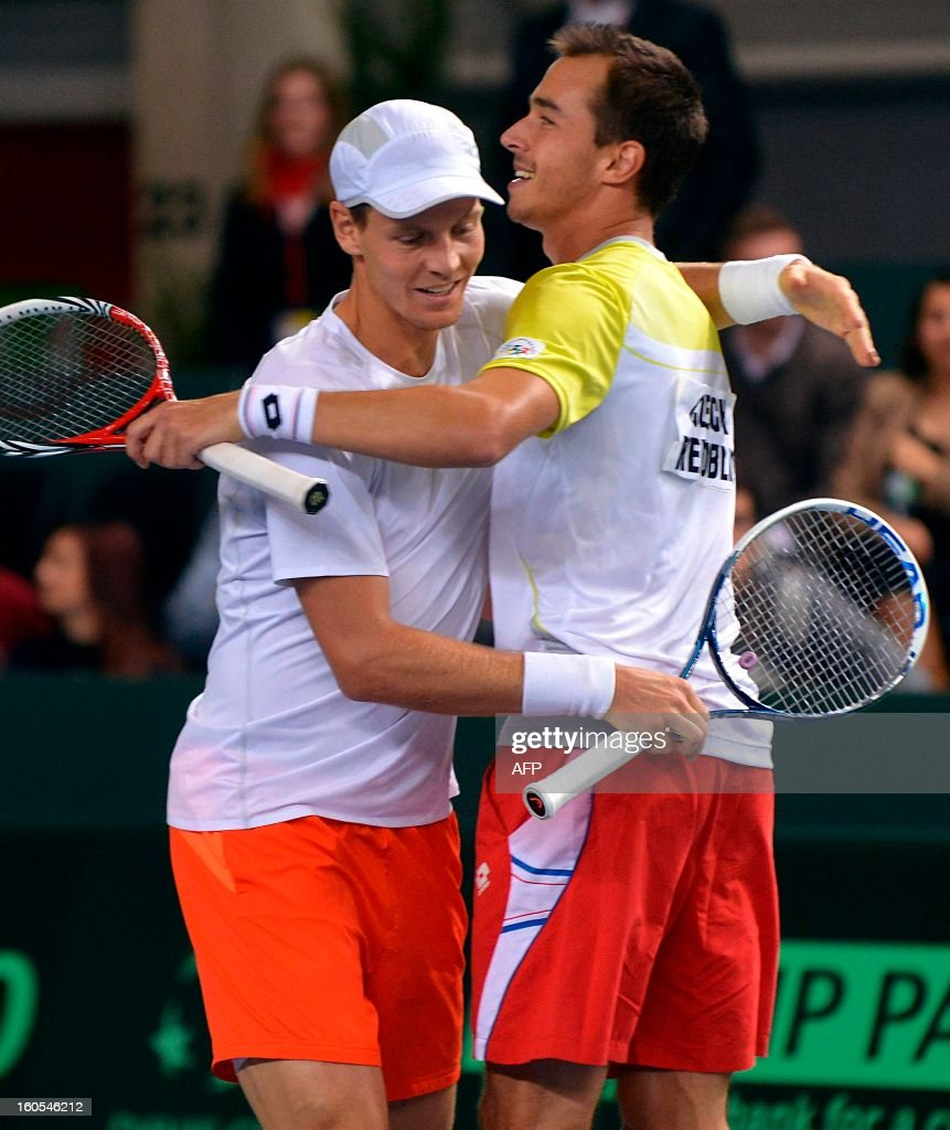 Czech pair Tomas Berdych (L) and Lukas Rosol celebrate their victory against Swiss player Stanislas Wawrinka and Marco Chiudinelli in the Davis Cup first round match, on February 2, 2013 in Geneva. The Czech Republic's Tomas Berdych and Lukas Rosol defeated Stanislas Wawrinka and Marco Chiudinelli of Switzerland 6-4, 5-7, 6-4, 6-7 (3/7), 24-22 in the longest Davis Cup rubber of all time.
