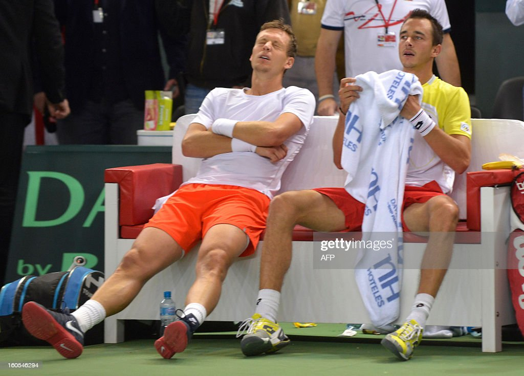 Czech pair Tomas Berdych (L) and Lukas Rosol react after defeating Swiss player Stanislas Wawrinka and Marco Chiudinelli in the Davis Cup first round match, on February 2, 2013 in Geneva. The Czech Republic's Tomas Berdych and Lukas Rosol defeated Stanislas Wawrinka and Marco Chiudinelli of Switzerland 6-4, 5-7, 6-4, 6-7 (3/7), 24-22 in the longest Davis Cup rubber of all time.