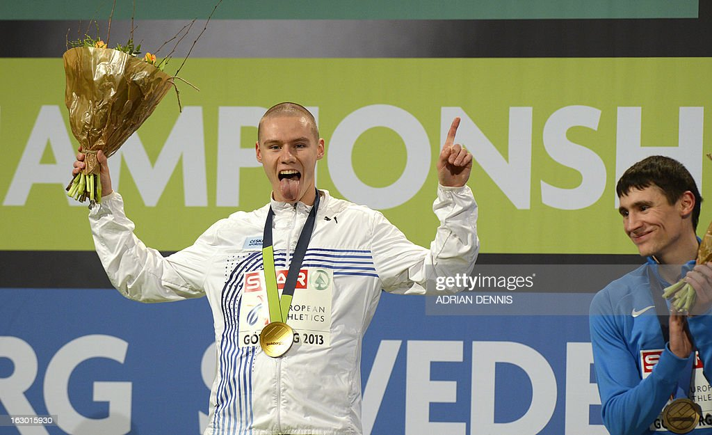 Czech Pavel Maslak (L) celebrates with his gold medal next to third placed Russia's Pavel Trenikhin on the podium after the men's 400m final at the European Indoor Athletics Championships in Gothenburg, Sweden, on March 3, 2013