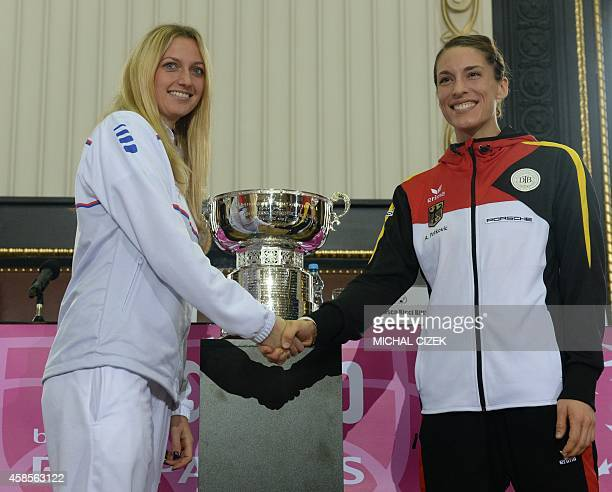 Czech Petra Kvitova shakes hand with German Andrea Petkovic after the International Tennis Federation Fed Cup final draw ceremony on November 7 2014...