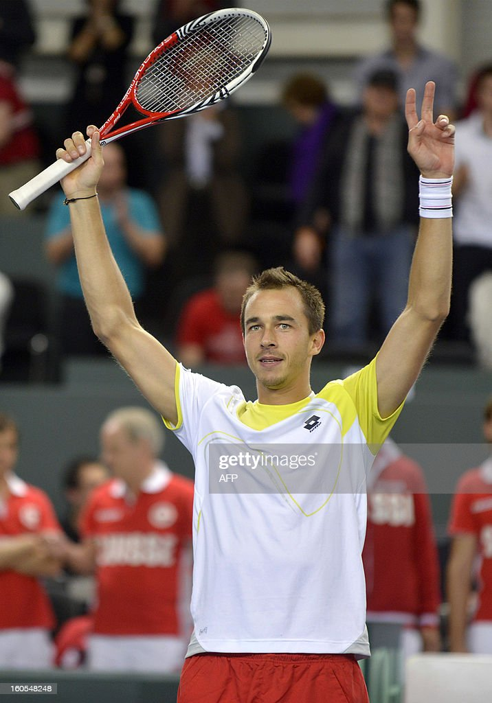 Czech player Lukas Rosol celebrates his victory with Tomas Berdych against Swiss player Stanislas Wawrinka and Marco Chiudinelli in the Davis Cup first round match, on February 2, 2013 in Geneva. The Czech Republic's Tomas Berdych and Lukas Rosol defeated Stanislas Wawrinka and Marco Chiudinelli of Switzerland 6-4, 5-7, 6-4, 6-7 (3/7), 24-22 in the longest Davis Cup rubber of all time.